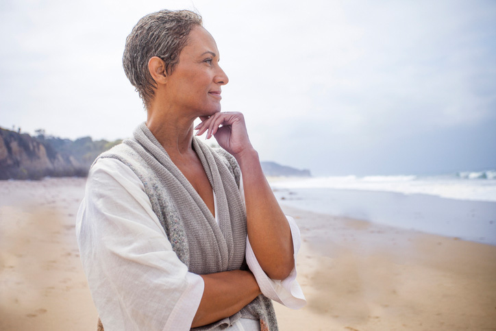 woman on beach considering preplanning funeral needs